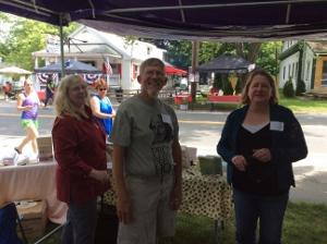 Lea Wait, John Clark, and Kelly McClymer from inside the tent