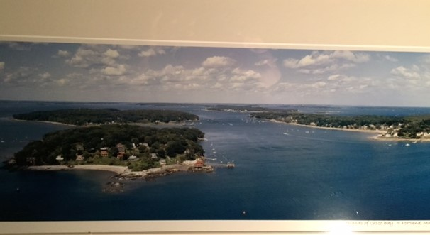 The photo of Casco Bay that hangs above my desk. Beautiful, and less distracting than a window.