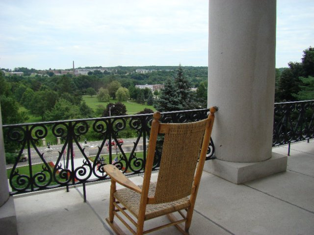 The balcony at Augusta's State House looks across the river to the grounds of the former Augusta Mental Health Institute -- the state hospital.