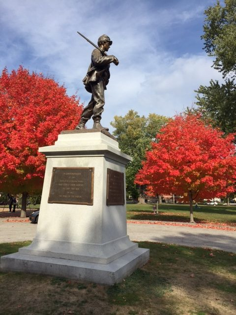 Red maples flank a solider at Riverbank Park on Main Street in Westbrook