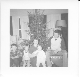 Mom, dad, John, Kate and Sara with our Christmas tree.
